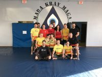 Group shot of New Orange Belts in Krav Maga