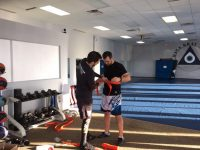 Student Receives Orange Belt in Krav Maga